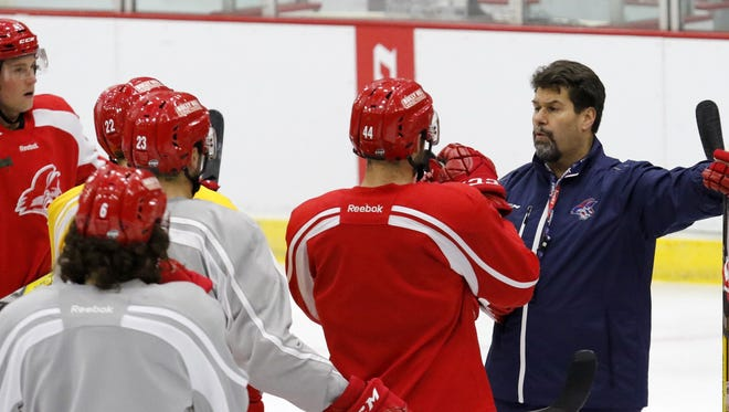 David Leger talks to the players at a preseason practice Oct. 12 at First Arena.