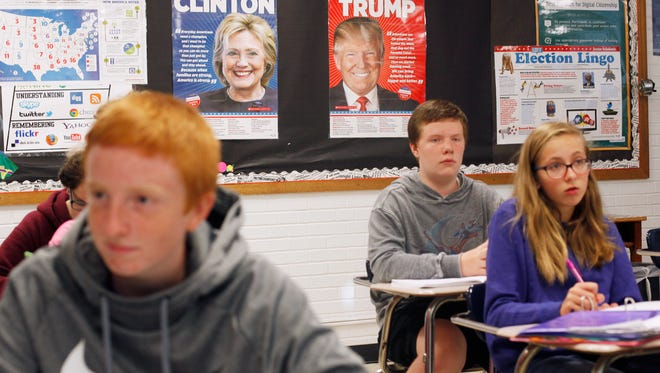 Posters of Hillary Clinton and Donald Trump hang in Loretta Wilson's class at Owen Middle School as the students study the presidential race.