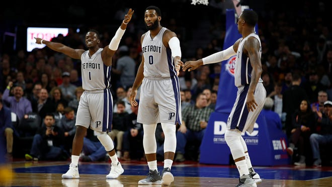 The Pistons' Andre Drummond, Reggie Jackson and Kentavious Caldwell-Pope celebrate a basket during the first half of the Pistons' 106-90 win Monday at the Palace.