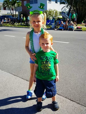 """We are waiting for the parade to start."" Raelyn is 4 and Myles is 2. Baby Isla is one month old."