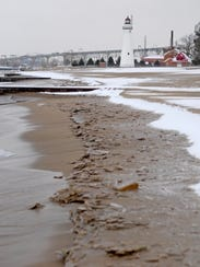 Snow and ice lay on the beach near the Fort Gratiot