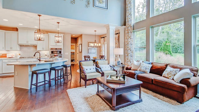 The open arrangement of the Bradford family room, kitchen and breakfast room makes it a comfortable place to relax with family and friends.