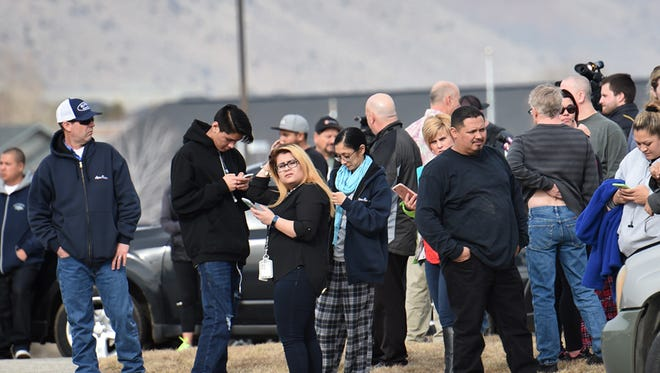 Spanish Springs high parents wait outside the school for their children to be released duirng a code red lockdown on Tuesday Jan.31, 2017.
