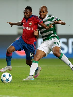 CSKA's Ahmed Musa, left, fights for the ball with Sporting's Naldo during their Champions League playoff second leg match.