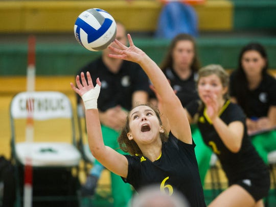 Catholic player sets the ball during a Volleyball substate