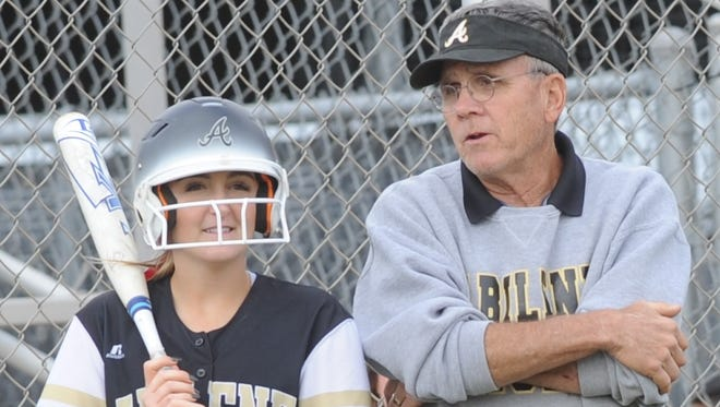 Abilene High softball coach Jim Reese, right, talks to Addison Kyker before she hits in the second inning against Keller Fossil Ridge on Friday, 20, 2018 at the AHS softball field. The Lady Eagles won the game 2-1 in eight innings.