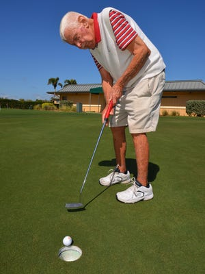 """Norman """"Fuzzy"""" Furbush, 88, still plays golf four times a week, many times beating his younger opponents. He caddied for some of the greats in the past."""
