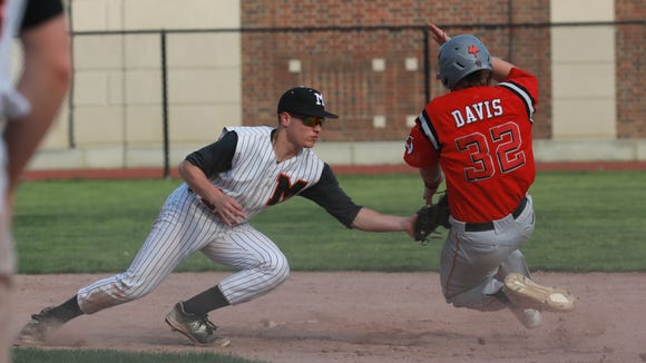 Mamaroneck's Michael Campbell (21) tags Fox Lane's  Henry Davis (32) during baseball game at Mamaroneck High School on May 7, 2018. Fox Lane defeats Mamaroneck 5-3.