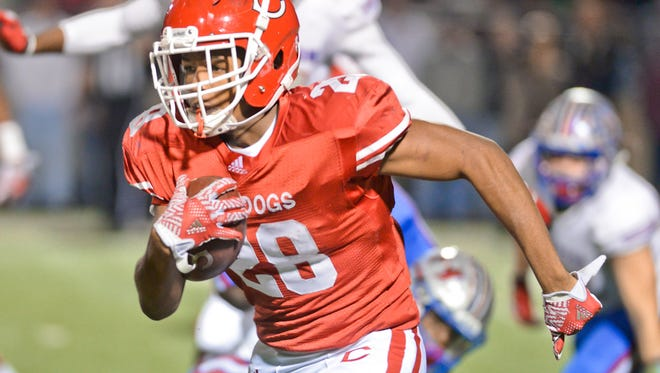 Carthage's Keaontay Ingram breaks through the line of scrimmage during the Bulldogs' 33-31 regional-round playoff win over Henderson on Nov. 25, 2016, at Longview's Lobo Stadium.
