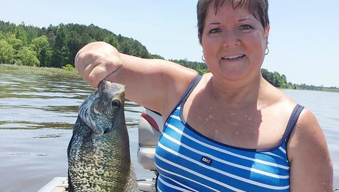 Trish Evans of Vicksburg holds a big Barnett Reservoir crappie in its spawning colors.