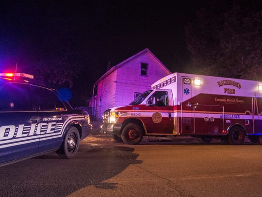 An ambulance leaves the scene of a shooting in the