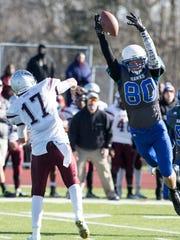St. Georges junior defensive lineman Christopher Davis bats down Hodgson quarterback Byron Cowen's pass.