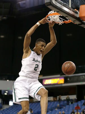 Manteca forward Kenny Wooten dunks against Ruben S. Ayla during the second half of the CIF boys' Division III high school championship game Thursday, March 24, 2016, in Sacramento, Calif. Manteca won 60-51.