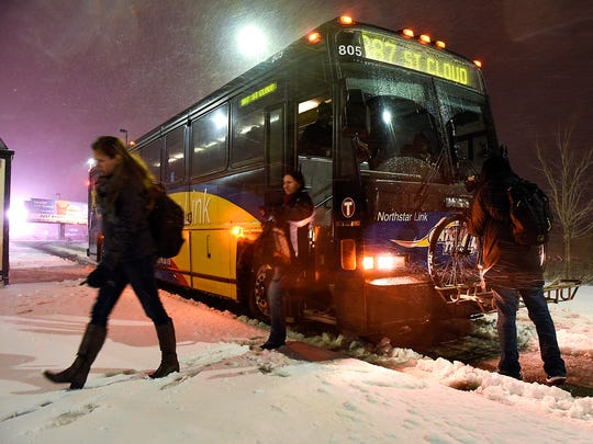 Riders get off the North Star Link bus in this November 2016 file photo, at the Eastside Park & Ride in St. Cloud. The bus line was supposed to be a pilot project to build ridership for an eventual extension of the Northstar rail service to St. Cloud.