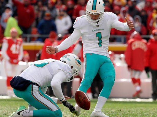 Miami Dolphins kicker Cody Parkey (1) boots a field goal during the first half of an NFL football game against Kansas City Chiefs in Kansas City, Mo., Sunday, Dec. 24, 2017. (AP Photo/Charlie Riedel)