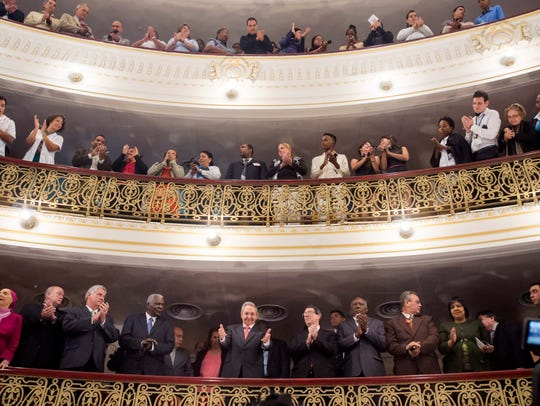 Cuban President Raul Castro receives applause after
