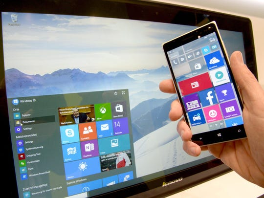 A user demonstrates the look and feel of Windows 10 operating system for smartphones and at the Microsoft stall at the CeBIT technology fair in Hanover, Germany.