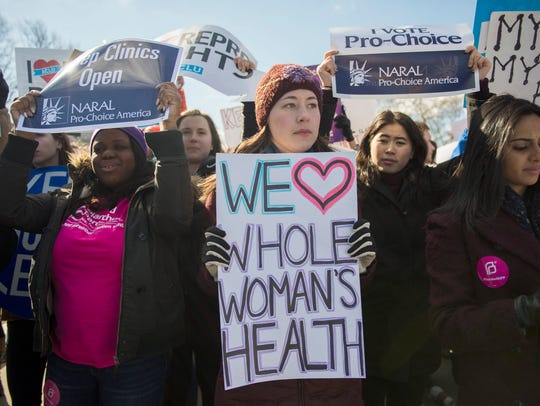 Abortion rights activists rally as the Supreme Court