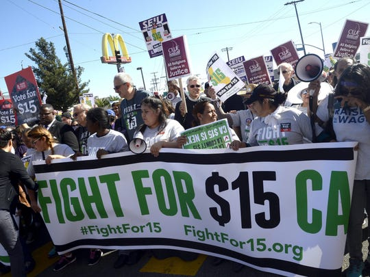 Fast-food workers have been demanding base pay of $15 an hour.