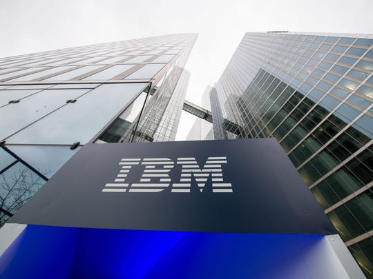 A file photo dated 15 December 2015 showing the logo of IBM seen at the entrance to the Highlight Towers in Munich, Germany. Technology corporation IBM is to release their 4th quarter results on 19 January 2016.