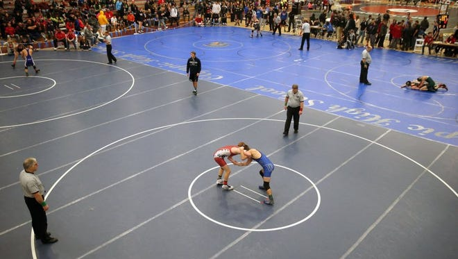 Wrestlers compete at the 2015 Gut Check Challenge at the Kitsap Sun Pavilion. The tournament features high school and college teams this weekend.