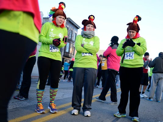 Runners try to stay warm before the York YMCA's 17th Annual YMCA Turkey Trot. This year's event will be Nov. 26.