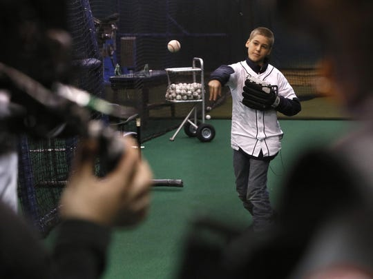 Cameras record as Hunter Bowman pitches to Tigers pitcher Daniel Norris inside one of the Tigers batting cages at Comerica Park on Feb. 13.