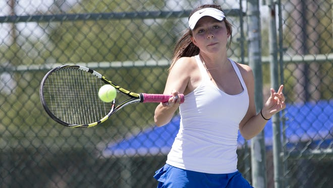 Xavier's Madison Clarke returns a ball during tennis action on May 10,2014.