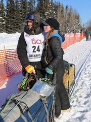 Nicolas Petit (left) and Emily Maxwell wait at the starting line for the 2017 Iditarod race in Fairbanks, Alaska.