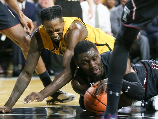 Wichita State forward Zach Brown and Temple center Ernest Aflakpu, right, battle for a loose ball during the first half of an NCAA college basketball game Thursday, Feb. 15, 2018, in Wichita, Kan. (Travis Heying/The Wichita Eagle via AP)