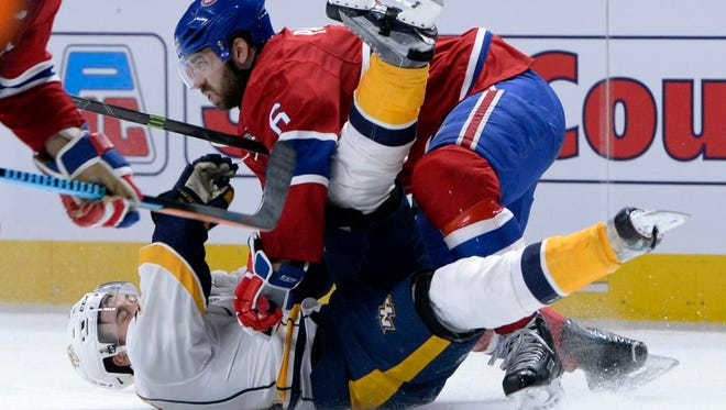Canadiens defenseman Greg Pateryn (6) hits Predators forward Viktor Arvidsson (38) during the second period at the Bell Centre.