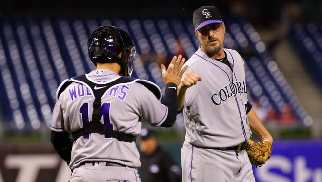 Rockies reliever Chad Qualls celebrates with catcher Tony Wolters after Colorado's victory against the Phillies at Citizens Bank Park in Philadelphia.