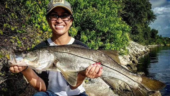 Rihannon Boyce, of Vero Beach, caught and released her first snook while fishing Wednesday in St. Lucie County with Jayson Arman of That's R Man land-based fishing charters.