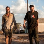 Guy Pearce, left, and Robert Pattinson star in the grim sci-fi Western 'The Rover.'