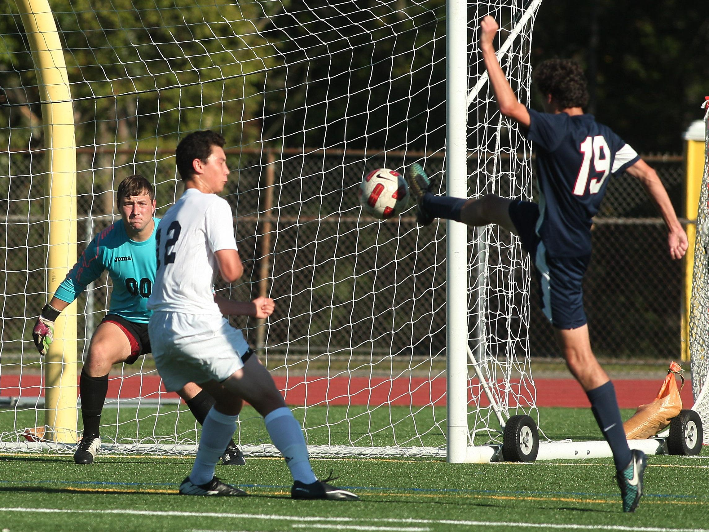 Mendham's Thomas Nobes tries for a goal but is stopped by Chatham defender Harrison Shi during Wednesday's game.