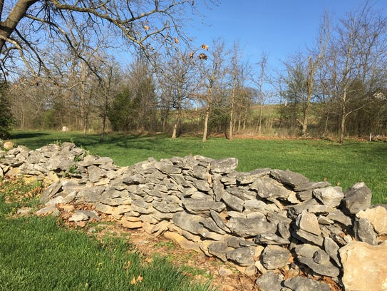 The stone wall at the Rivercut Golf Course is about