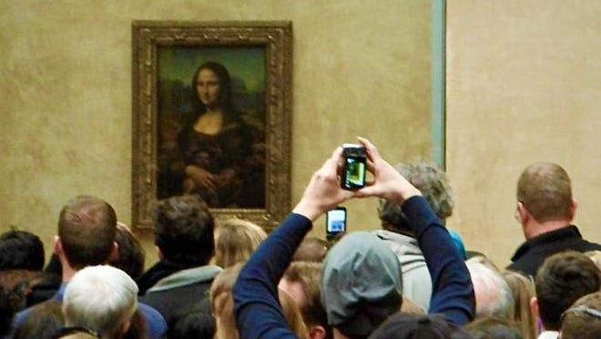 Mona Lisa smiles at the lines of casual art tourists corralled in the Louvre.