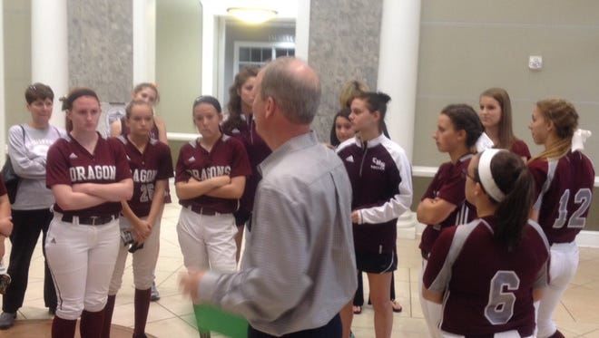 Parent Jay Eubank talks with female athletes and other adults after the group raised complaints about equity between girls' and boys' sports at Collierville High School.