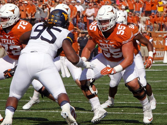 FILE - In this Nov. 12, 2016, file photo, Texas lineman Connor Williams (55) blocks against West Virginia lineman Christian Brown during the first half of an NCAA college football game, in Austin, Texas. Williams was named to the AP Preseason All-America Team on Tuesday, Aug. 22, 2017. (AP Photo/Michael Thomas, File)
