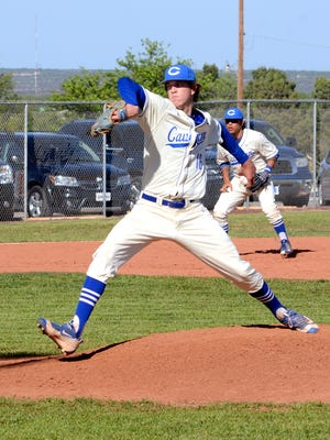 Carlsbad's Trevor Rogers fires a pitch in game one Friday against Hobbs.