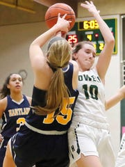 Hartland's Andrea Everett (15) and Howell's Kaylee