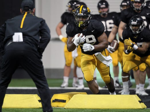 Iowa running back LeShun Daniels, Jr. runs drills during