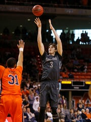Vanderbilt forward Luke Kornet (3) takes a shot over Auburn  guard Devin Waddell (31) on Feb. 13, 2016.