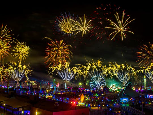 Fireworks fill the sky over the festival grounds during the opening night of the Electric Daisy Carnival at the Las Vegas Motor Speedway in Las Vegas on Saturday, June 17, 2017.