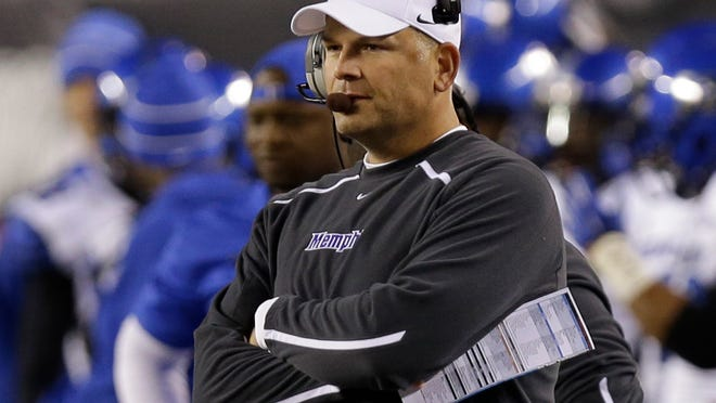 Memphis coach Justin Fuente watches from the sideline in the first half against Cincinnati in Cincinnati.