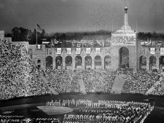 FILE -  In this July 30, 1932, file photo, doves are released during opening ceremonies of the Tenth Olympiad at the Coliseum in Los Angeles. The Los Angeles City Council is expected Friday, Aug. 11, 2017 to endorse a proposal to host the 2028 Olympics, following an announcement of a deal last month to leave 2024 to Paris.(AP Photo)