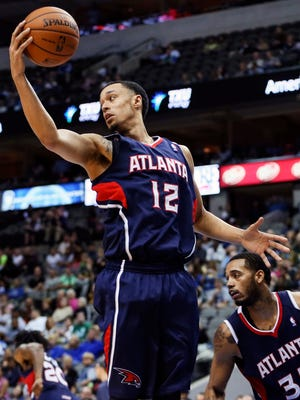 Shooting guard John Jenkins, shown Oct. 23 in a preseason game, has not played much for the Hawks this season and will miss the rest of it after back surgery.