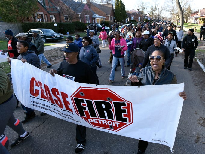 More than 200 people walk northbound on Murray Hill