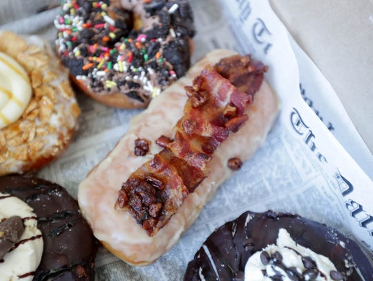 The maple bacon praline doughnut is the restaurant's most popular, according to Cholak.