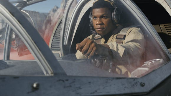 Finn (John Boyega) steers a Ski Speeder on Crait.